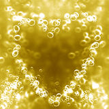 Champagne bubbles in the shape of a heart. Champagne bubbles in the shape of a golden heart Stock Image