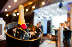 Champagne in a bucket. At a party Royalty Free Stock Image