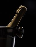 Champagne bucket on black background Royalty Free Stock Images