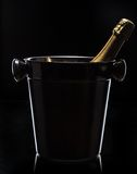 Champagne bucket on black background Royalty Free Stock Image