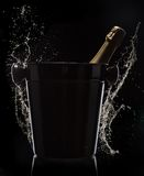 Champagne bucket on black background Stock Photos