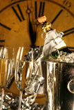 Champagne in bucket with glasses. Ready for New Years festivities Royalty Free Stock Photos