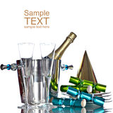 Champagne In Bucket, Hat, Green & Blue Crackers. Champagne In Silver Bucket With White Plates, Gold Party Hat, and Green And Blue Party Favors Stock Photo