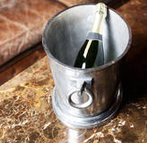 Champagne bucket in vintage room Royalty Free Stock Photos