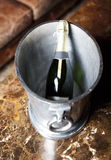 Champagne bucket in vintage room Royalty Free Stock Photography