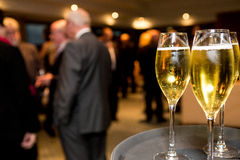 Champagne at business social event Royalty Free Stock Image