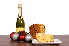 Champagne and cake isolated Stock Photography