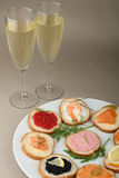 Champagne and canapes Stock Photos