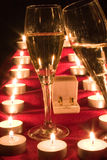 Champagne and candle Stock Images