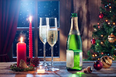 Champagne with candles color back. Close up view of champagne with candles color back stock images