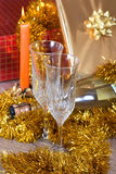 Champagne candles and gifts. Champagne, candles and gifts for Christmas Royalty Free Stock Photo