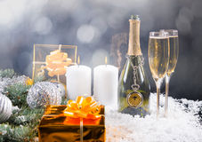 Champagne, Candles and Gifts in Festive Still Life Stock Image