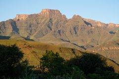 Champagne Castle, Cathkin Peak and Monk`s Cowl: peaks forming part of the central Drakensberg mountain range, South Africa stock photo