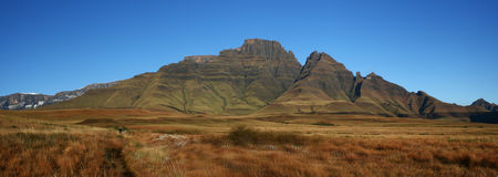 Champagne Castle, Gatberg, Sterkhorn. South Africa Drakensberg. Hiking party in distance Royalty Free Stock Photography