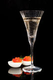 Champagne and caviar. Royalty Free Stock Image