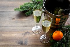 Champagne for celebrate New Year 2018. Glasses, tangerine, spruce branch on wooden background copyspace Royalty Free Stock Image