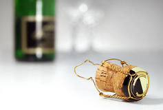 Champagne Celebration. Champagne cork in foreground, bottle and glasses in background, celebration Royalty Free Stock Image