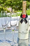 Champagne. A bottle of champagne and two glasses Royalty Free Stock Photos