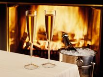 Champagne chilling by the fire Stock Photo