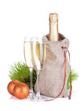Champagne and christmas baubles Stock Photography