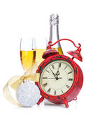 Champagne, christmas decor and alarm clock Stock Image