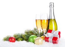 Champagne, christmas decor and gift box Royalty Free Stock Images