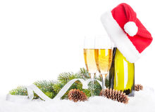 Champagne, christmas decor and santa hat Stock Photos