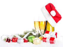Champagne, christmas decor and santa hat Royalty Free Stock Images