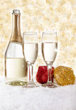 Champagne and Christmas decorations on golden background. Champagne in glasses on golden background,new year concept Stock Image