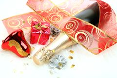 Champagne and Christmas decorations Royalty Free Stock Photo