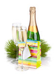 Champagne and christmas gift Royalty Free Stock Photography