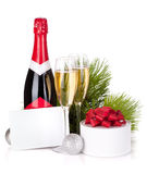 Champagne and christmas gifts Royalty Free Stock Photos