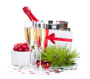 Champagne and christmas gifts Royalty Free Stock Photography