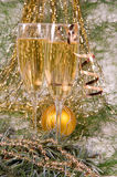 Champagne and Christmas ornaments. Royalty Free Stock Images