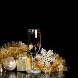 Champagne with Christmas ornaments Stock Image