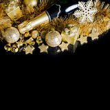 Champagne with Christmas ornaments Royalty Free Stock Photography