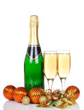 Champagne with Christmas ornaments Stock Photography