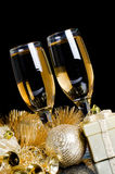 Champagne with Christmas ornaments Royalty Free Stock Photos