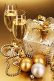 Champagne and christmas present Stock Photography