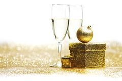 Champagne with christmas present Stock Images