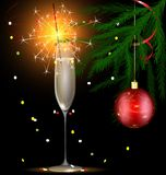Champagne and Christmas sparkler Stock Photography