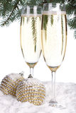 Champagne and Christmas toys Stock Photos