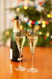 Champagne with Christmas tree in the background Royalty Free Stock Photo