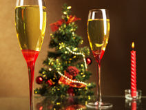Champagne, Christmas tree and candle Stock Photography