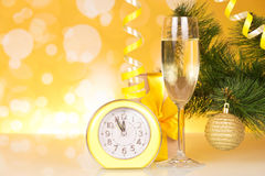 Champagne and clock Stock Images
