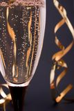 Champagne close-up. Close-up of champagne in a glass and streamers, focus is on the glass Stock Photo