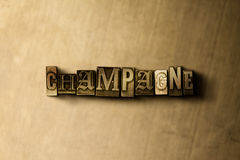 CHAMPAGNE - close-up of grungy vintage typeset word on metal backdrop Stock Photography