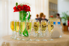 Champagne at the cocktail party. People in the background. Blurred background Stock Image