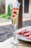 Champagne con il lampone Fotografia Stock