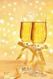 Champagne con l'indicatore luminoso della sfuocatura Immagini Stock Libere da Diritti